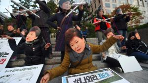A protest in Seoul, Korea, where people wore masks of Choi Soon-sil and Park Geun-hye, satirizing Choi's invisible control of Korean politics
