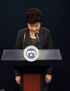 President Park Geun-hye bowed to the press before delivering an apology to the general public